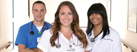 three smiling medical workers